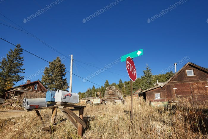 Old mail boxes and stop sign in remote village.