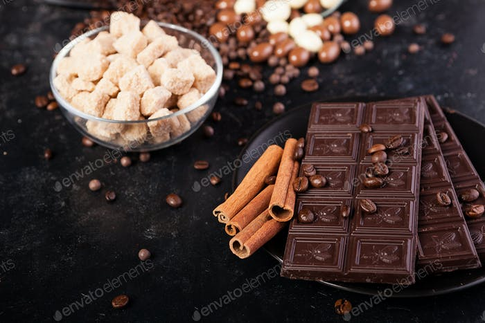 Chocolate tablets next to cinnamon rolls and other sweets and candies