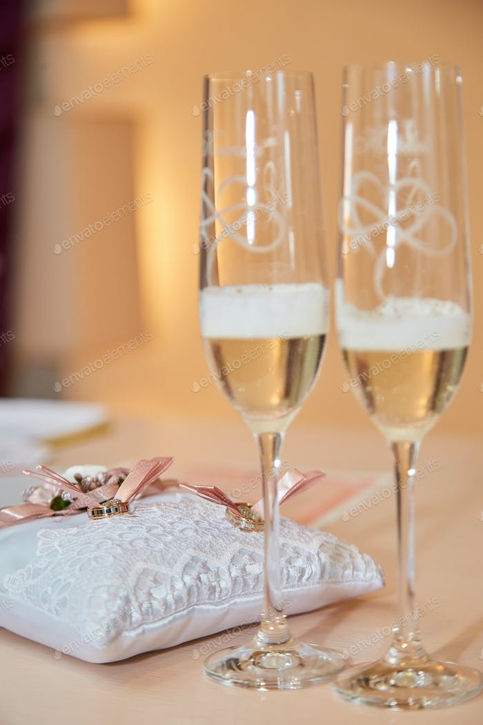 Thumbnail for Two glasses of a champagne and pillow with wedding rings