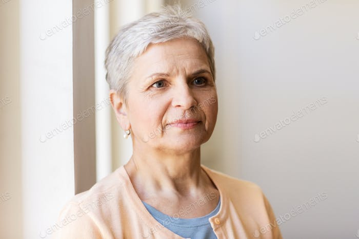 portrait of happy gray senior woman