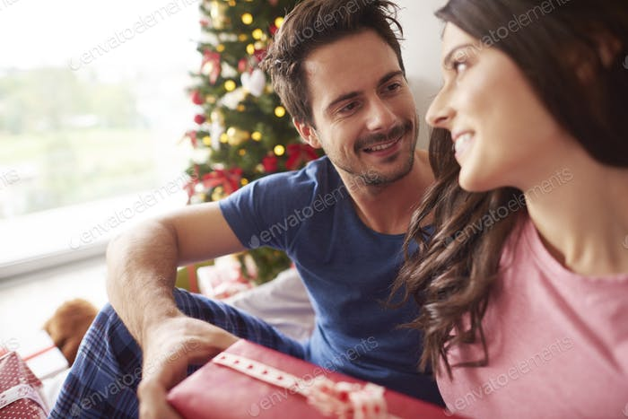 Couple exchanging their Christmas presents