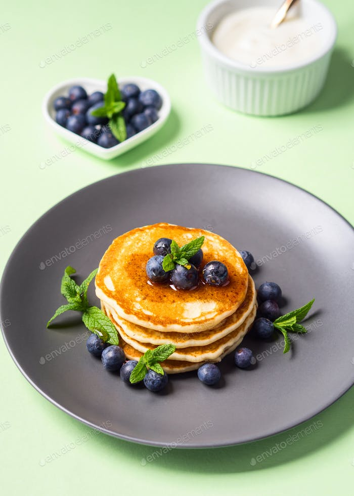 Home made pancakes served with fresh berries