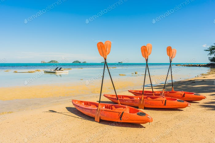Empty kayak boat or ship on the tropical beach and sea
