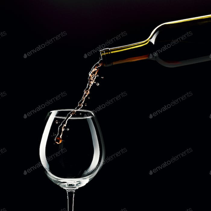 Pouring red wine in a wineglass