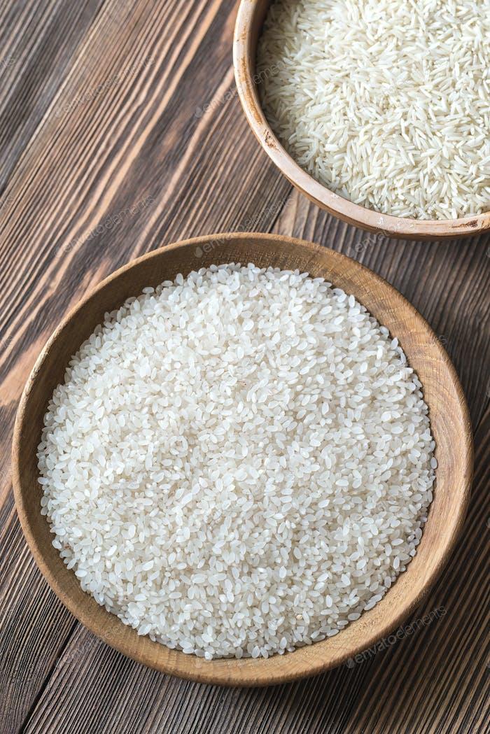 Bowls of uncooked camolino and basmati rice