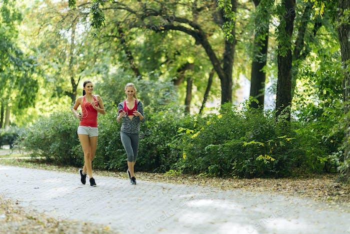 Sportive women jogging in park