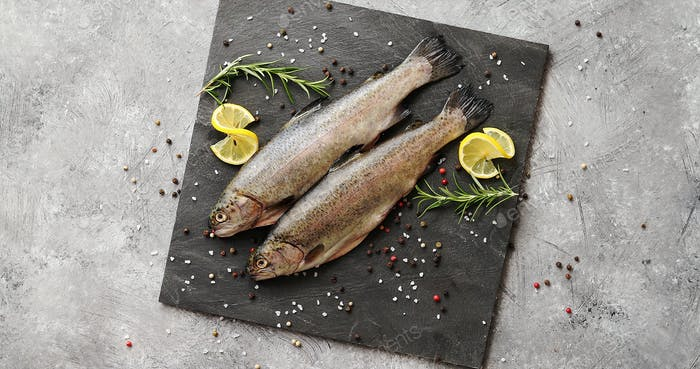 Fish with lemon on board