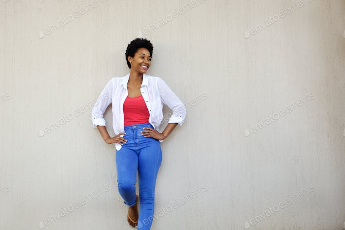 Attractive stylish african woman looking at copy space