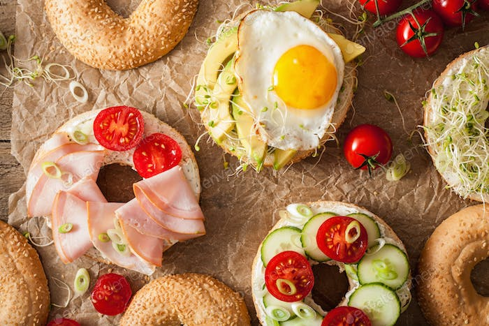 Thumbnail for variety of sandwiches on bagels: egg, avocado, ham, tomato, soft