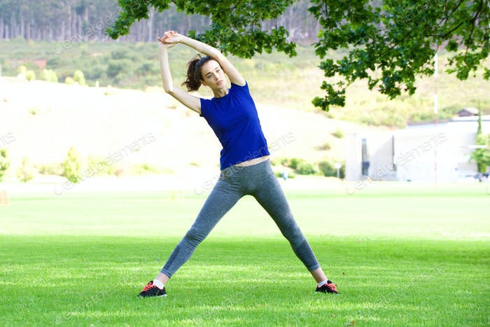 Woman stretching outdoors in park