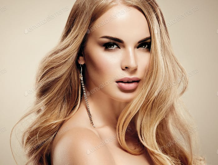 Beautiful woman portrait face studio curly blonde long hair