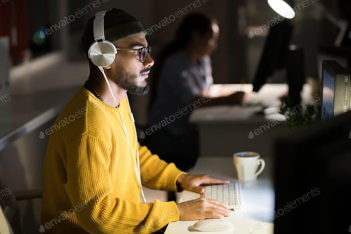 Computer Programmer Coding at Night