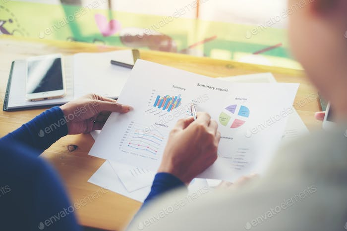 business woman hands pointing holding business graph information diagram.