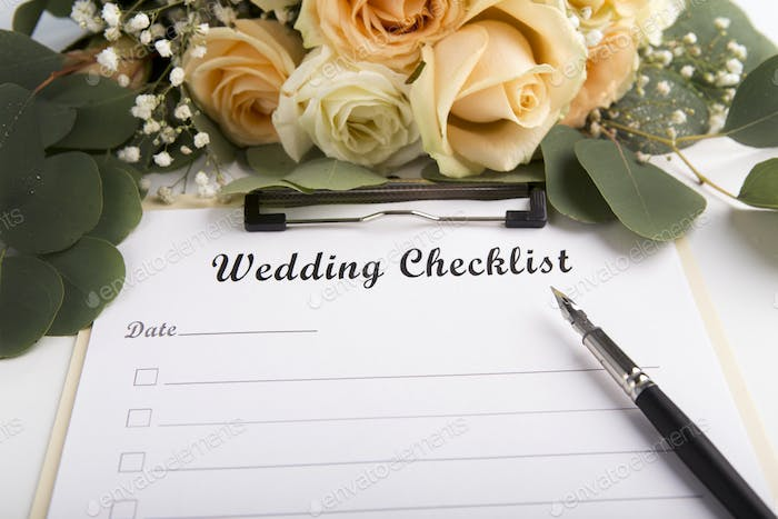 Wedding checklist is ready to be full of items on white sheet