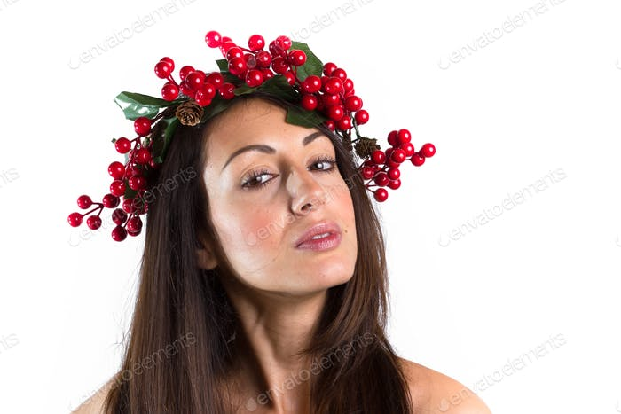 Smiling woman with a Christmas wreath on her head