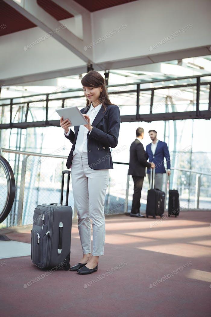 Businesswoman using digital tablet on platform