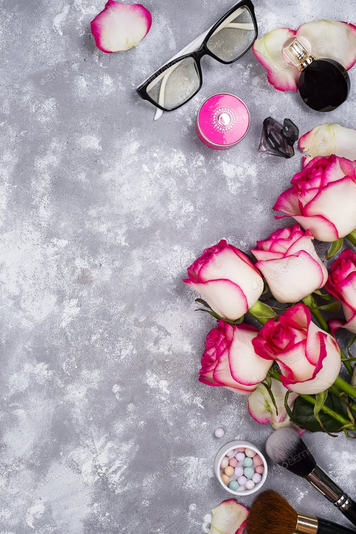 Roses and decorative cosmetics as frame
