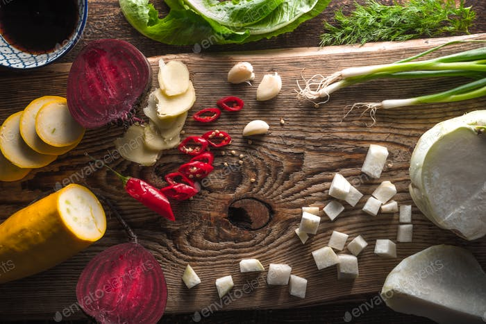 Kohlrabi, beet, chili on a wooden table