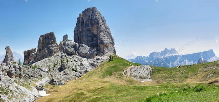 Summer mountain alpine meadow landscape. Cinque Torri, Dolomites, Italy