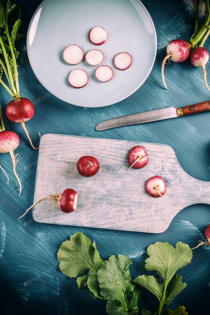 Whole and slice of radishes