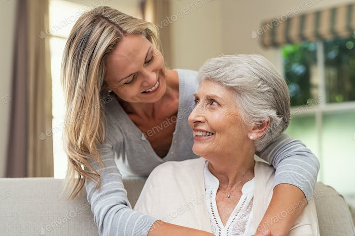Woman embracing senior mother