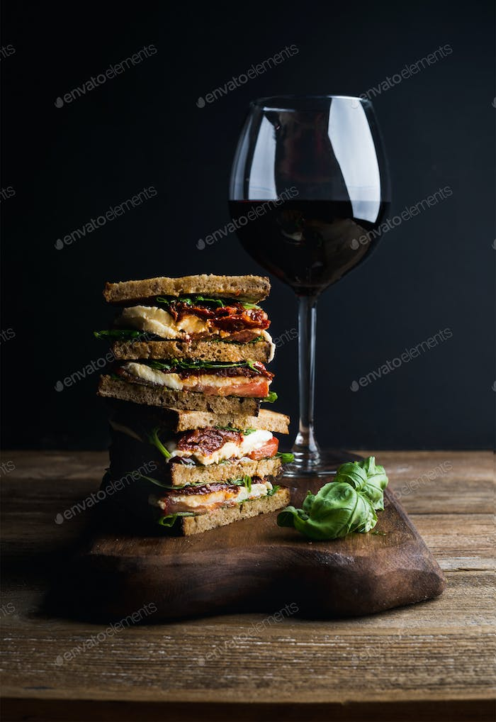 Caprese sandwich or panini and glass of red wine