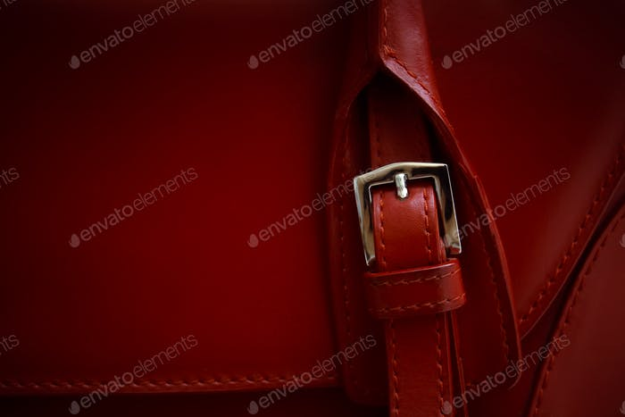 Red glossy female leather bag