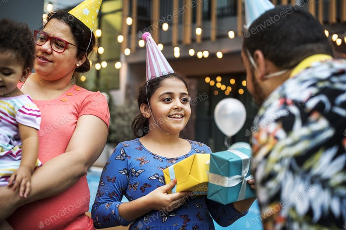 Father give birthday gift to daughter