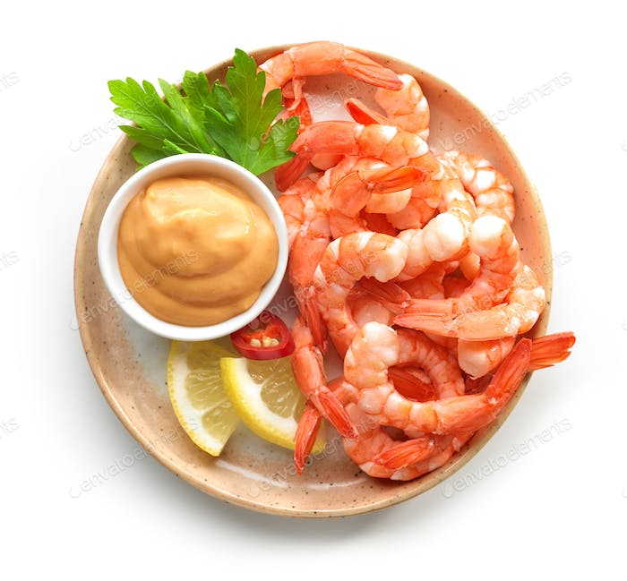 plate of boiled prawns and salsa sauce