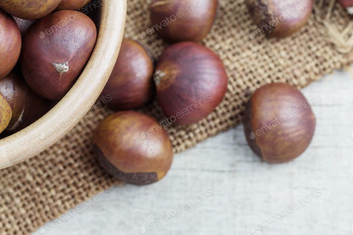 Chestnuts on wooden