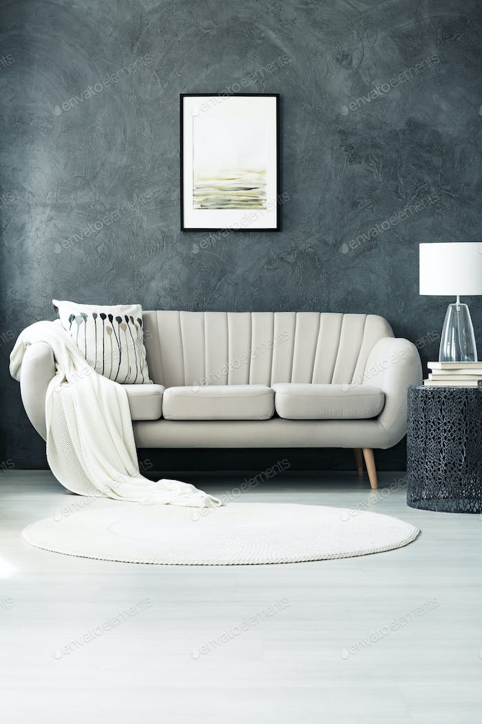 Sofa by dark grey wall
