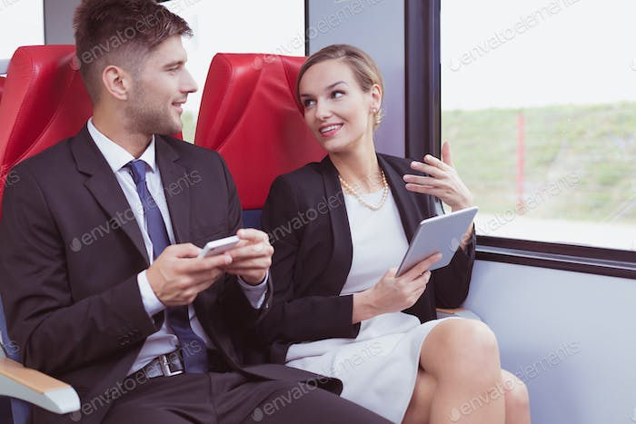 Man and woman in train