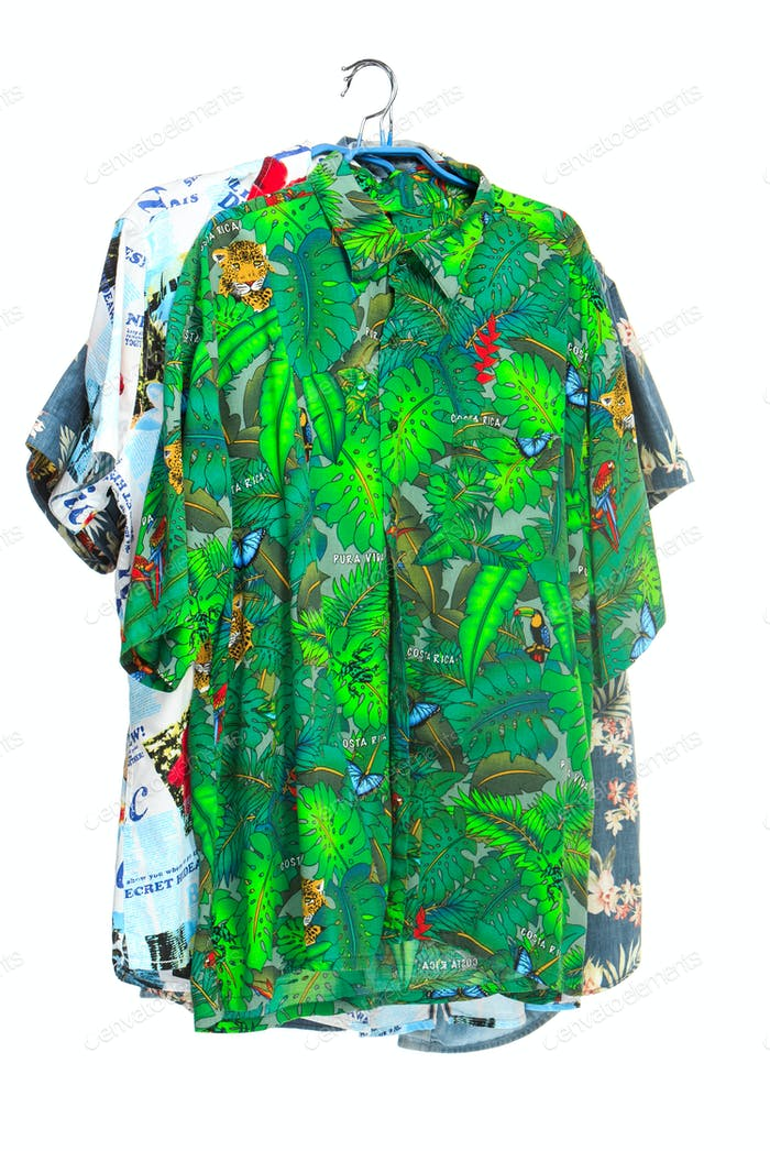 The isolated tropical shirts on white