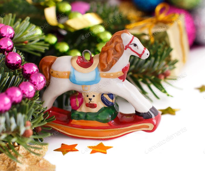 Festive decorations with  rocking horse, baubles