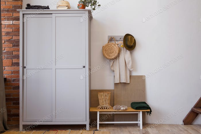 Rustic eco style interior made of natural materials. Wooden wardrobe in the room
