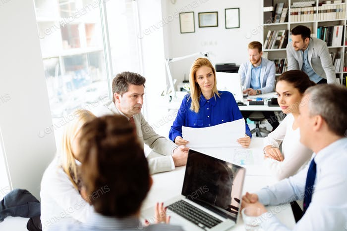 Businesspeople collaborating in office