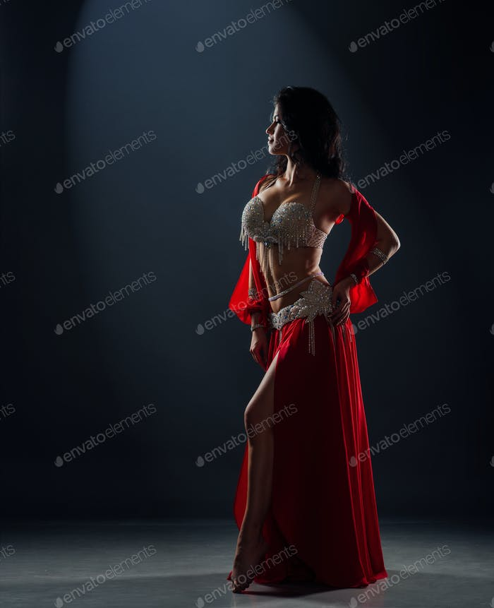 beautiful black-haired girl in red ethnic dress on stage
