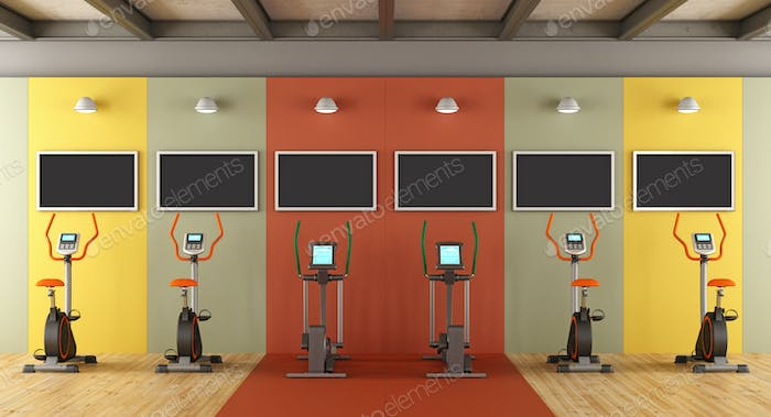 Colorful gym with statiobary bike