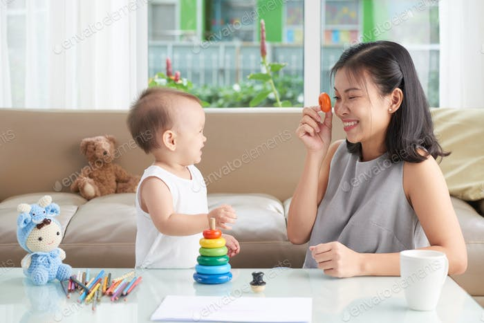 Mother playing with daughter