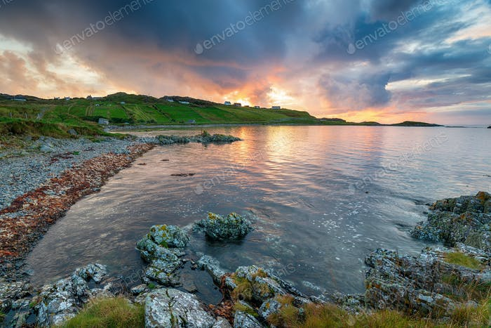 Stormy sunset sky over the rugged beach at Scourie