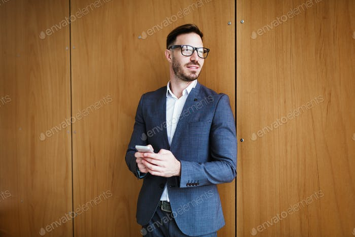 Portrait of a successful businessman wearing glasses and suit