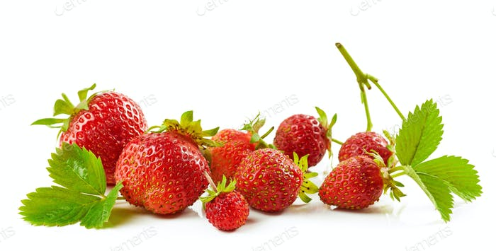 fresh red strawberries with green leaves