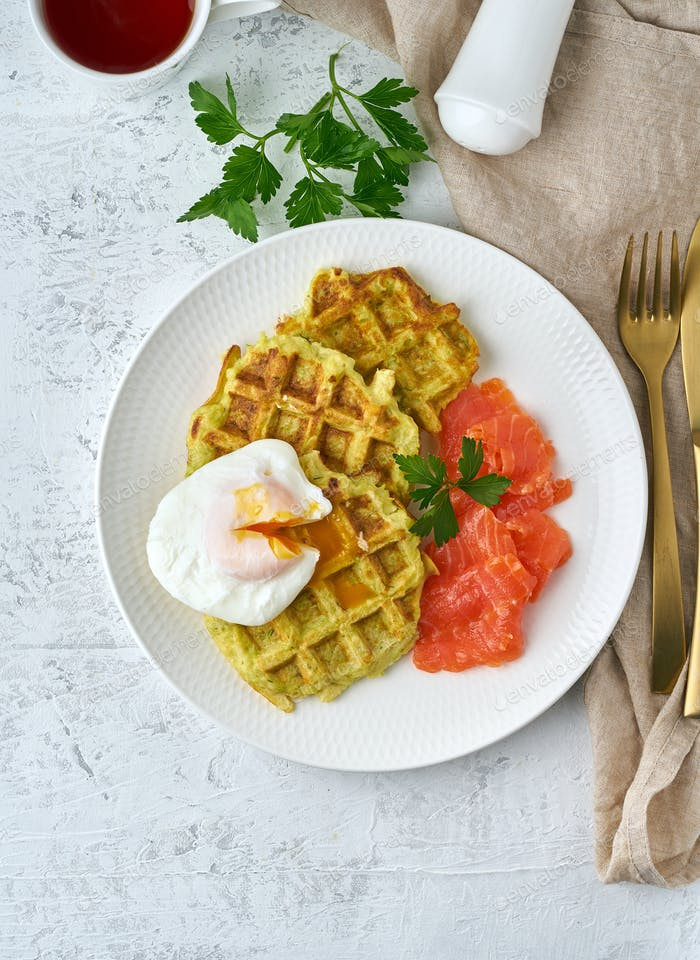 Zucchini waffles with salmon and benedict egg, fodmap diet top view