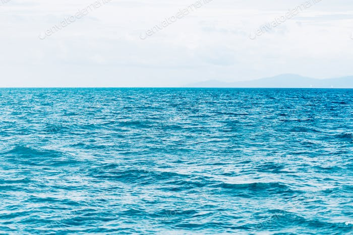 Bright Blue ocean with smooth wave background