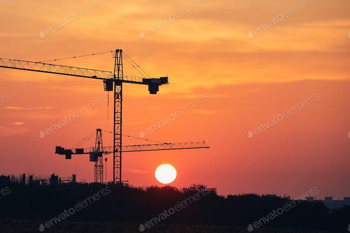 Building activity on contruction site at sunrise