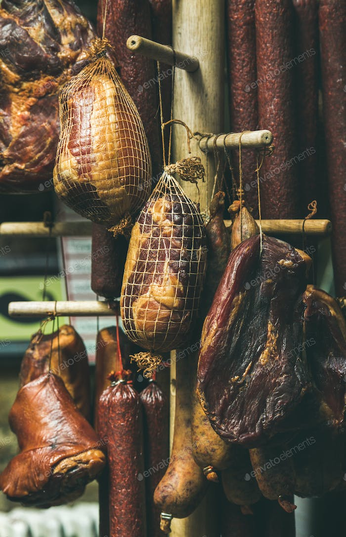 Variety of hanging traditional Hungarian smoked meat and sausages