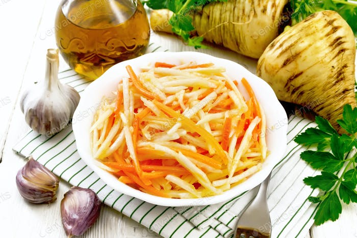 Salad of parsnip and carrot on napkin