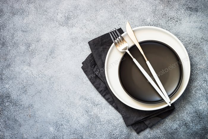 Cutlery set at stone kitchen table top view