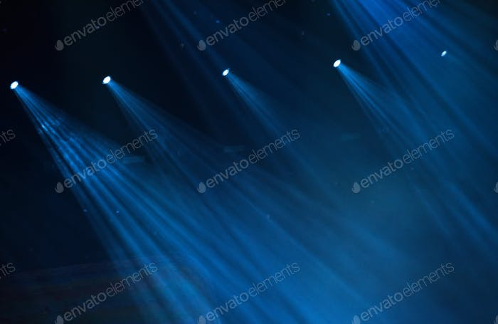 Blue stage lights during a rock concert
