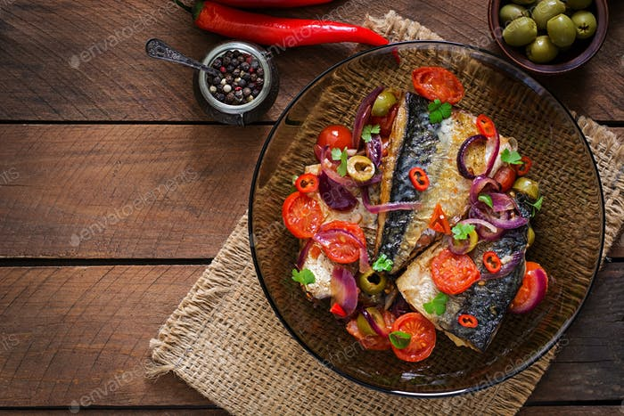 Grilled mackerel with vegetables in Mediterranean style. Top view